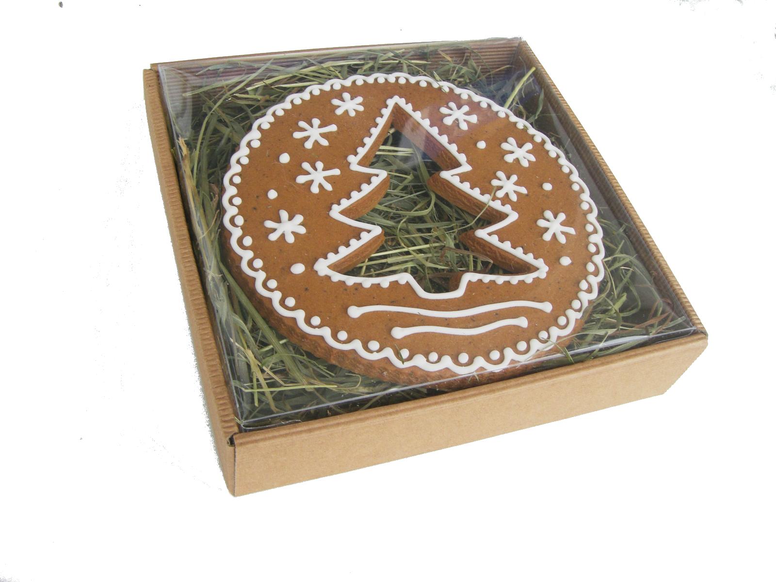 piernik okrągły wielkości około 13cm z dziurką w kształcie choinkiw pudełku w kształcie koła, z dziura w kształcie choinki