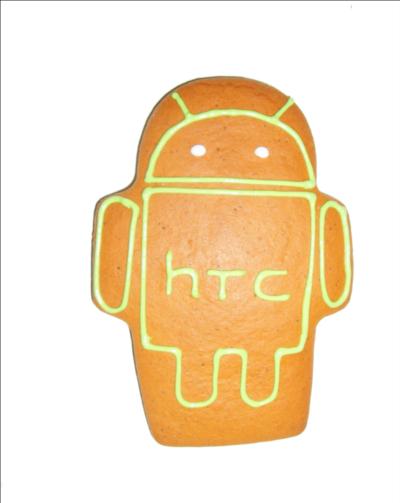 Piernik reklamowy w kształcie robota z wylukrowanym na zielono logo Androida