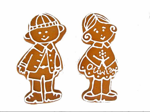 dwa pierniki w kształcie chlopca i dziewczynki wylukrowane na biało